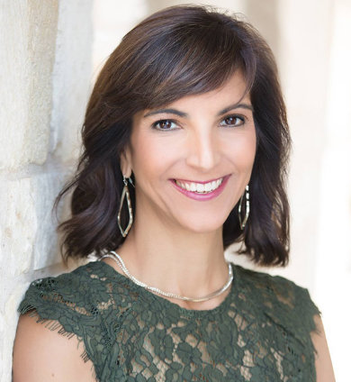 Austin, TX oculoplastic facial surgeon, Dr. Malena Amato, in a green blouse
